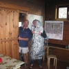 Martin tries out Mike's survival bag in the comfort of the Andara hut