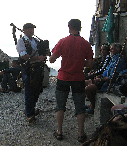 Playing pipes outside the Andara hut